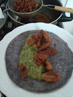 Chicharrón taco with blue tortilla